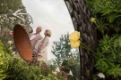 People reflected in the sculptures of David Harber Gold Award Winner