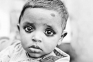 Indian baby with charcoal eyes