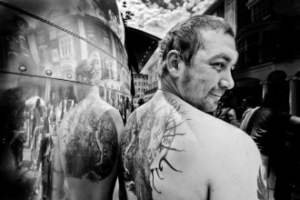 tatooed man in shiney american airstream